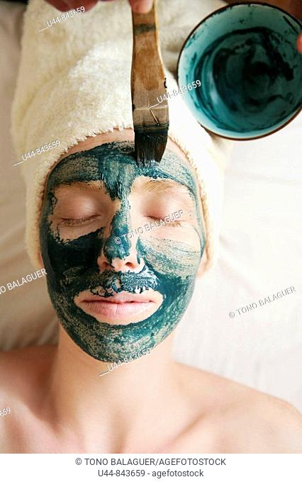 Green clay face skin theraphy massage, woman
