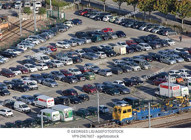 Cars in a parking lot next to a station in Le Havre, Normandy, France