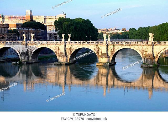 Rome, Italy. View of famous Sant' Angelo Bridge. River Tevere. Sunset light