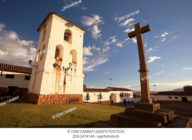 Scene from the town center with a wooden cross in the foreground, Chinchero, Valle Sagrado, Cuzco, Peru, South America