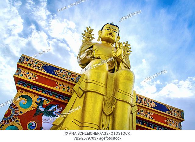 Maitreya, the futur Buddha. Golden Buddha statue in Likkir (Ladakh, India) seatting in a color decorated bench