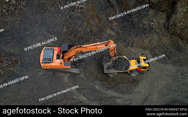 14 February 2020, Rhineland-Palatinate, Bundenbach: Near Bundenbach slate is mined in an open pit (aerial photo with a drone)