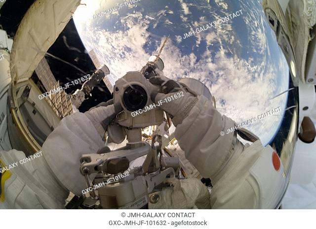 Expedition 33 Flight Engineer Akihiko Hoshide takes a picture of his helmet visor while participating in a 6-hour, 38-minute spacewalk outside the International...