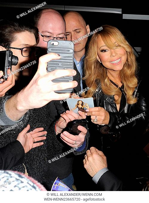 Mariah Carey is swamped by fans as she arrives back at her hotel, having performed in Cardiff earlier in the evening Featuring: Mariah Carey Where: London