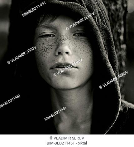 Caucasian boy with freckles wearing hoody