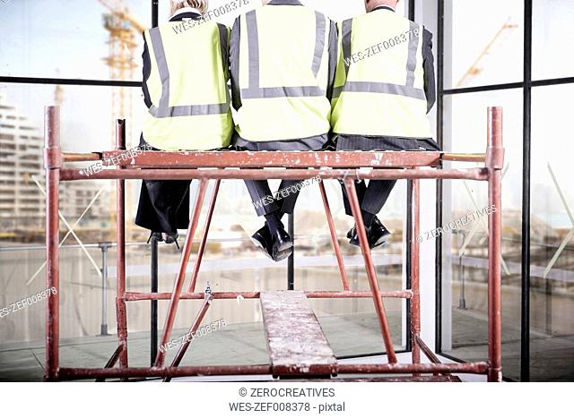 Architects having a break on scaffolding