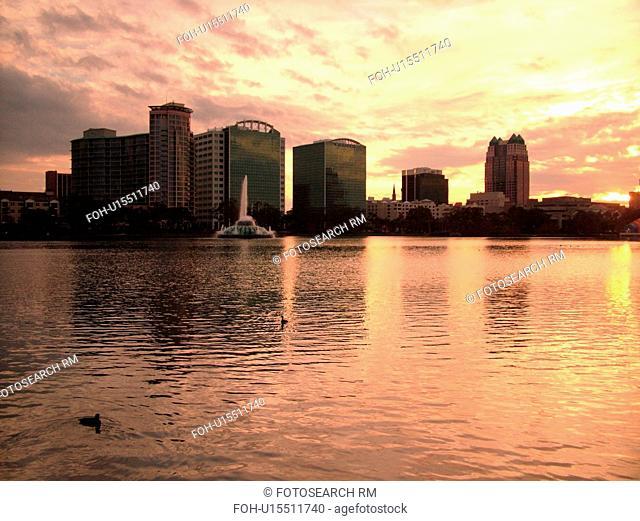 Orlando, FL, Florida, Downtown skyline, Lake Eola, Lake Eola Park, sunset