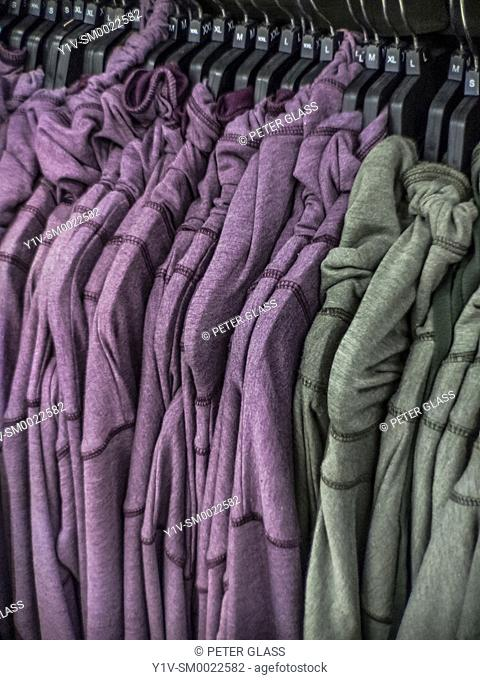 Sweatshirts hanging in a clothing store