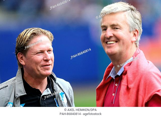 FILE- A file picture dated 19 October 2014 depicts the former Hoffenheim coach and current HSV coach Markus Gisdol speaking with Hamburg's sports director...