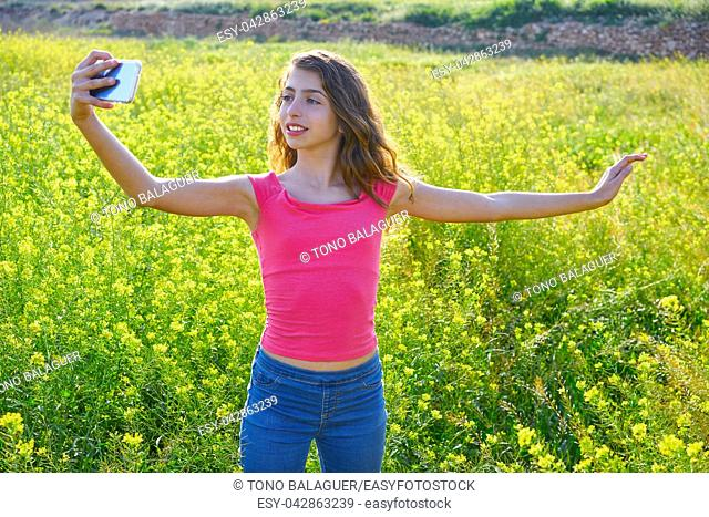 Teen girl selfie video photo in spring meadow