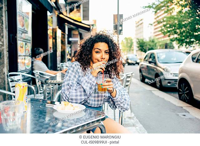 Woman at pavement cafe, Milan, Italy