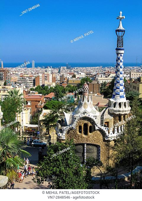 View of city of Barcelona from Parc Guell, Barcelona, Spain, Europe. Image taken from steps above the main entrance gate in front of one of the pavillions...