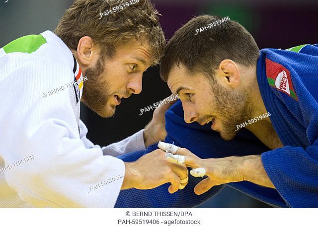 Germanys Sebastian Seidel (white) competes with Dzmitry Shershan of Bulgaria in the Men's -66kg Judo Repechage at the Baku 2015 European Games in Heydar Aliyev...