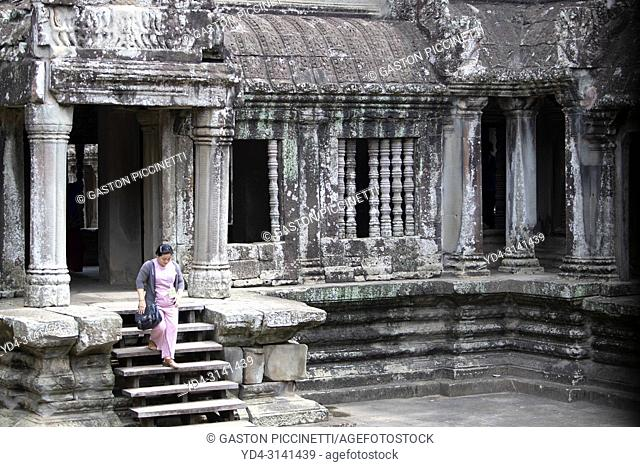 Tourist exploring the Angkor Wat Temple, Angkor Temple Complex, Siem Reap Province, Cambodia, Asia, UNESCO. It was originally constructed as a Hindu temple...