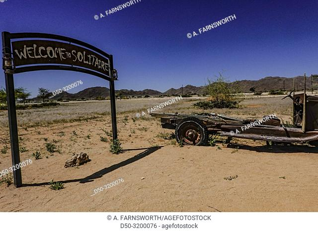 The entrance sign ot the gas station in Solitaire, the only gas station around for miles. Old cars. Solitaire, Namibia