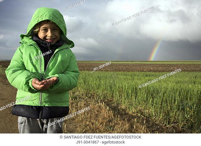 Smiling kid holding bug. Paracuellos del Jarama, Madrid province, Spain