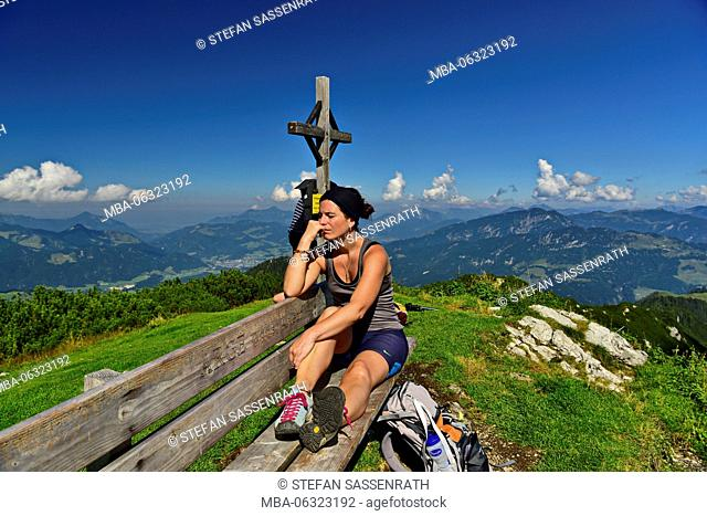 young woman sitting on bench at the Feldberg summit