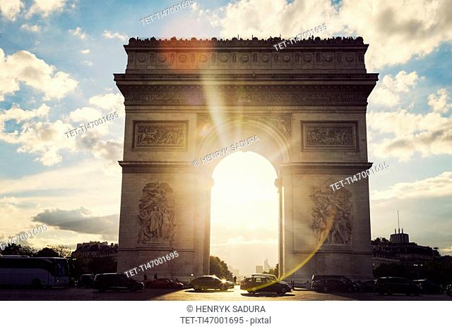 France, Paris, Arc de Triomphe at sunrise