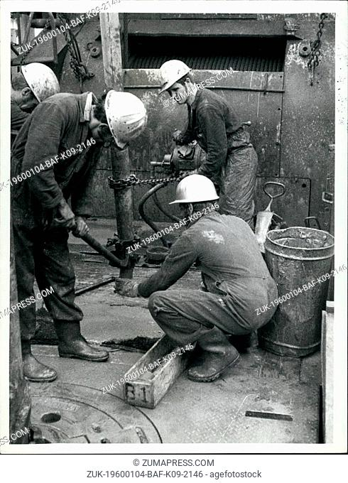 Feb. 24, 1968 - Offshore United Kingdom North Sea. Exploration & Production Releasing core from barrel and laying in sequence in 3ft core sample boxes