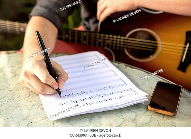 Close up of young man composing music