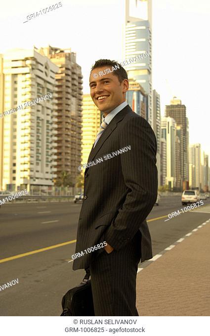 Portrait of a businessman on Shaikh Zayed Road in Dubai