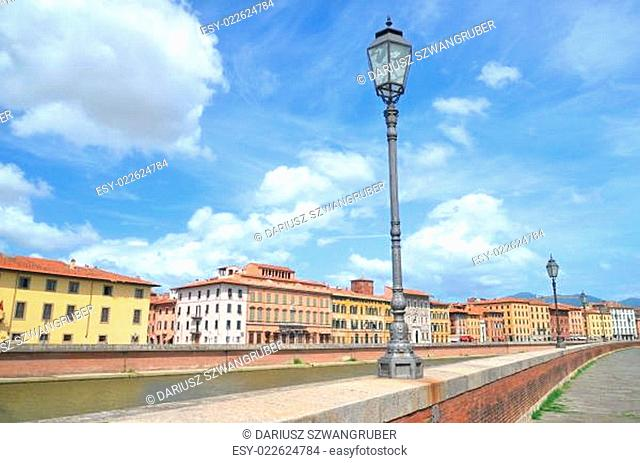 Picturesque colorful historic buildings along Arno river in Pisa, Italy