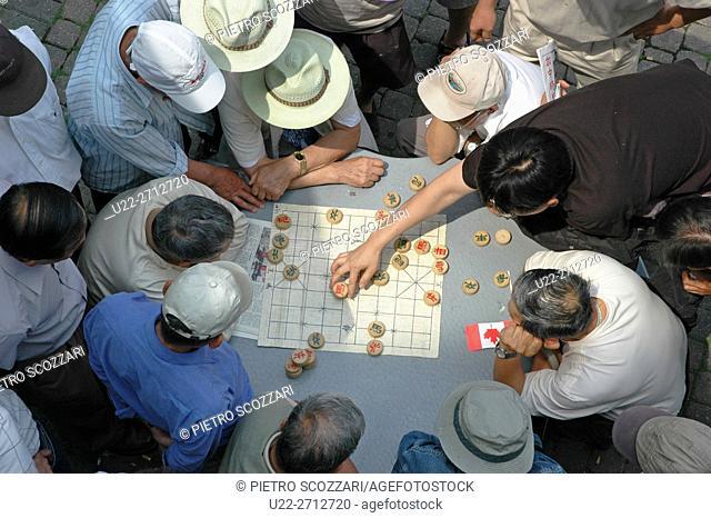 Toronto, Canada: Chinese men playing Chinese chess at Chinatown