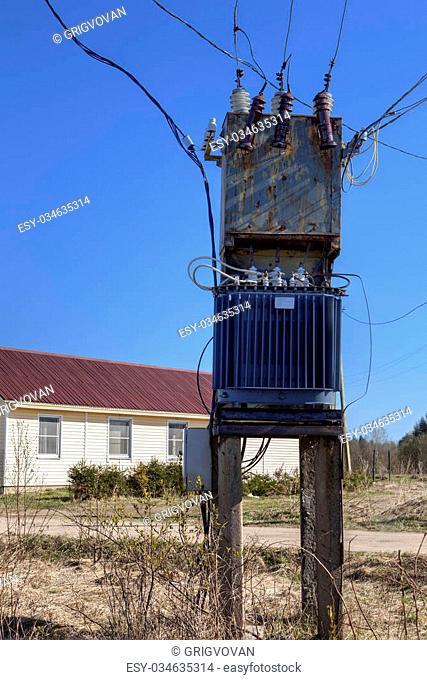Voltage power transformer substation at village near farmhouse