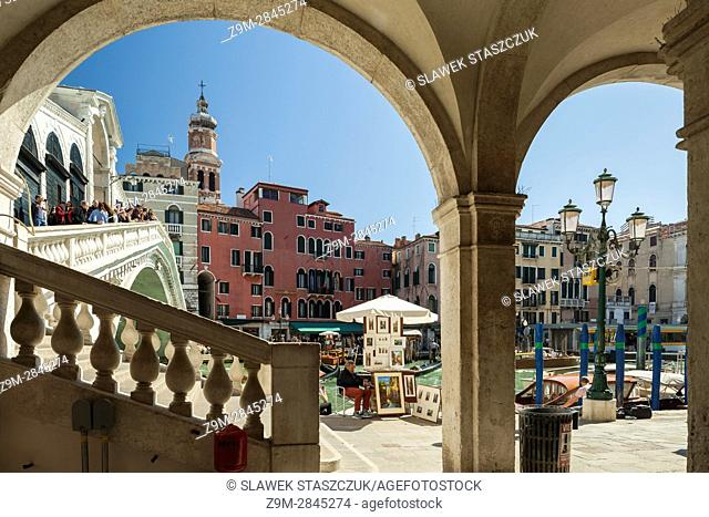 Rialto Bridge seen from an arcade in the sestiere of San Polo, Venice, Italy