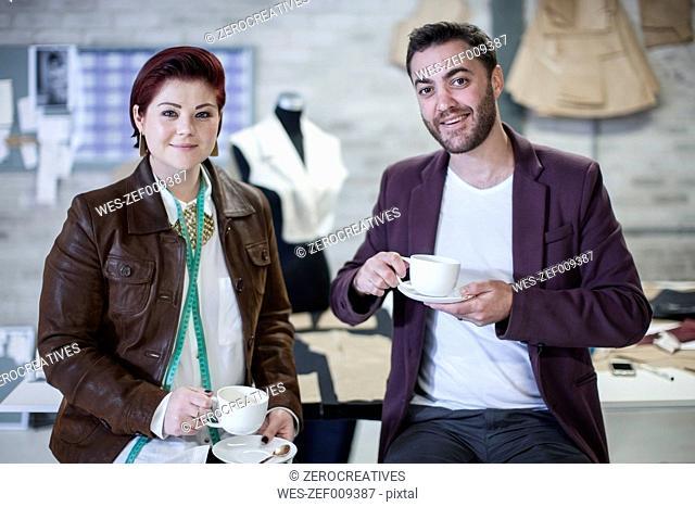 Portrait of two fashion designers