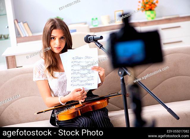 Female beautiful blogger playing violin