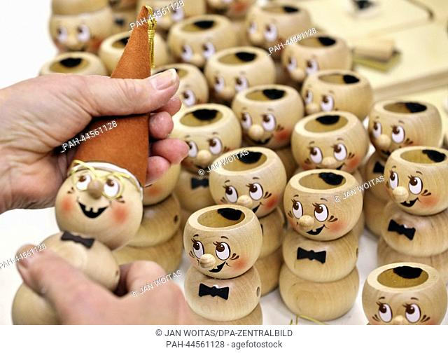 """A smoke worm """"""""Book Rudi"""""""" is assembled in the Kuhnert turnery workshop in Rothenkirchen,Germany, 26 November 2013. Nutcrackers"""