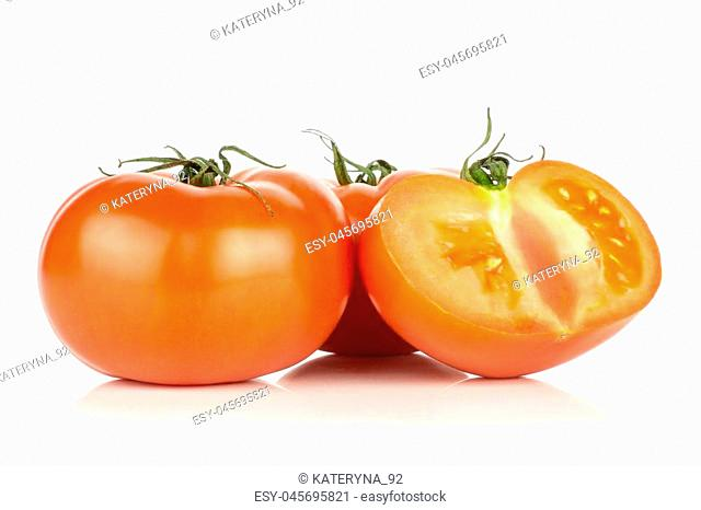 Two red tomato and one half isolated on white background