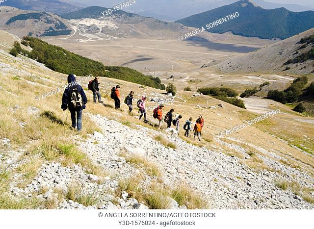People climbing mountains in Abruzzi region, Italy