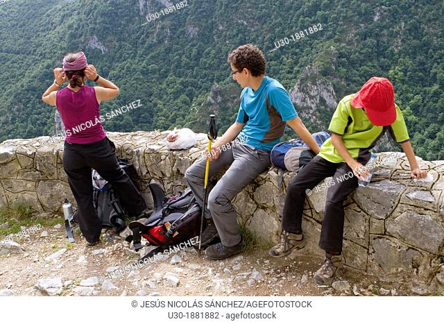 Hikers walking up to Tresviso, a small village in Picos de Europa National Park by historic Urdón path from La Hermida Gorges  Peñarrubia  Cantabria, Spain