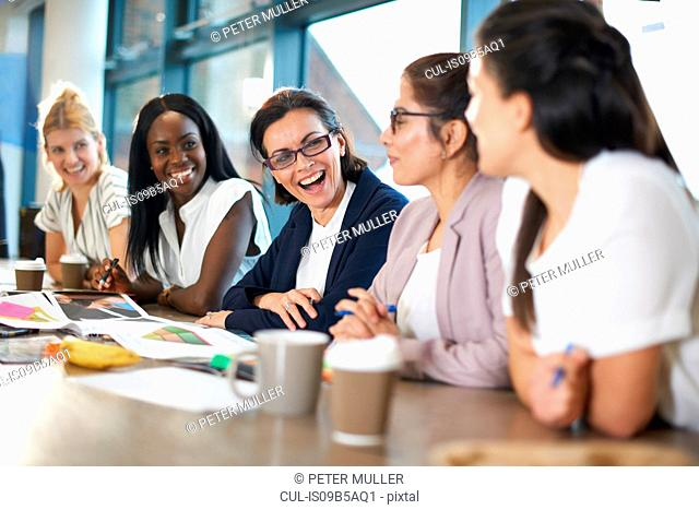 Colleagues having meeting at conference room table