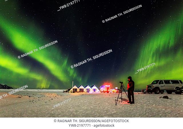 Photographing the Aurora Borealis or Northern lights, Iceland Cafe, tourist shop at the Jokulsarlon, Breidamerkurjokull, Vatnajokull Ice Cap, Iceland
