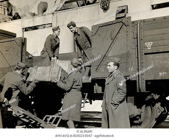 Foodstuffs & Munitions being unloaded in Naples Port from the Italian troops, shot 1944