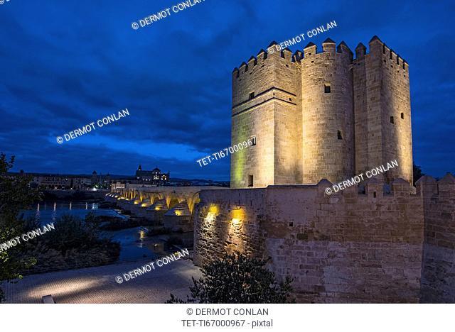 Spain, Andalusia,Cordoba, Illuminated, old church near bridge over Guadalquivir river