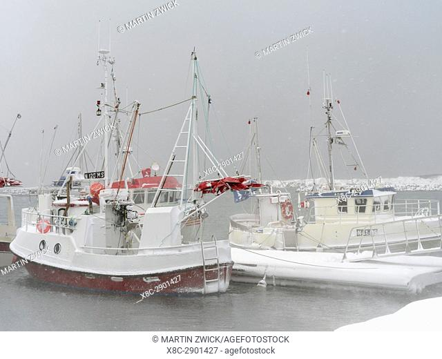 Harbour during winter storm with fishing boats. Village Ramberg on the island Flakstadoya. The Lofoten Islands in northern Norway during winter