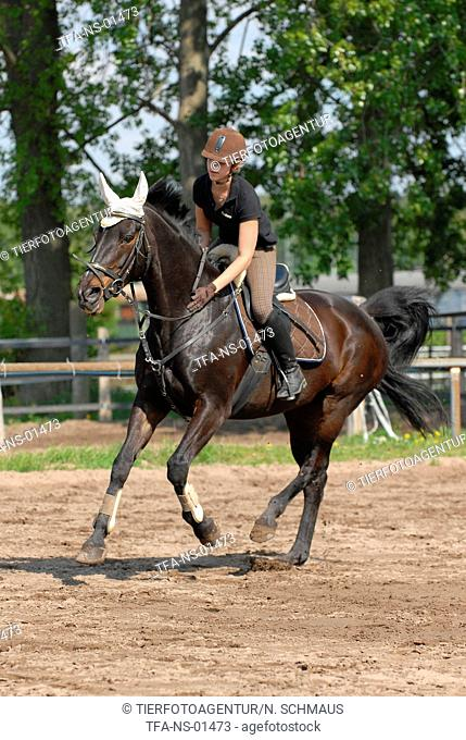 woman rides horse