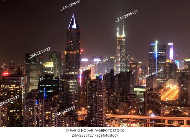 Shanghai, China - March 2, 2017: Shanghai skyline at night with the Shimao International Plaza and Tomorrow Square Towers on background