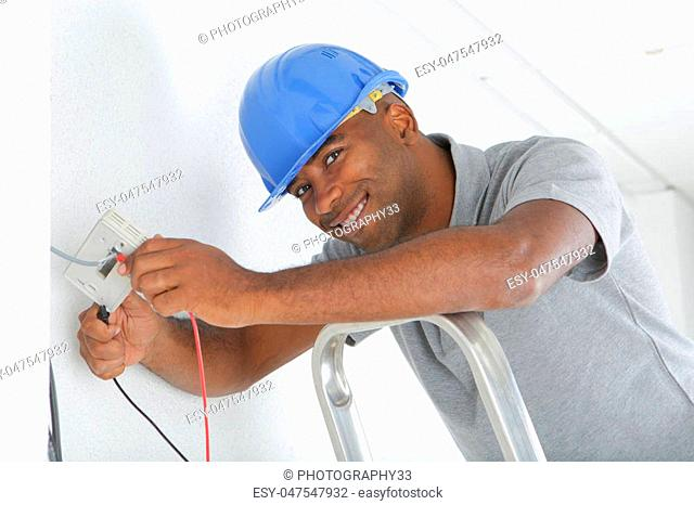 Portrait of electrician wiring