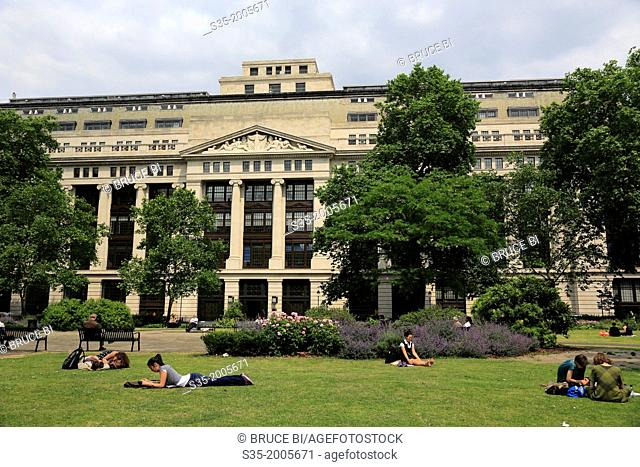 People sunbathing in Bloomsbury Square. London. England. United Kingdom