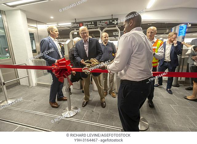 MTA Chairman Joe Lhota receives the ceremonial ribbon-cutting scissors at the Cortlandt Street-World Trade Center subway reopening