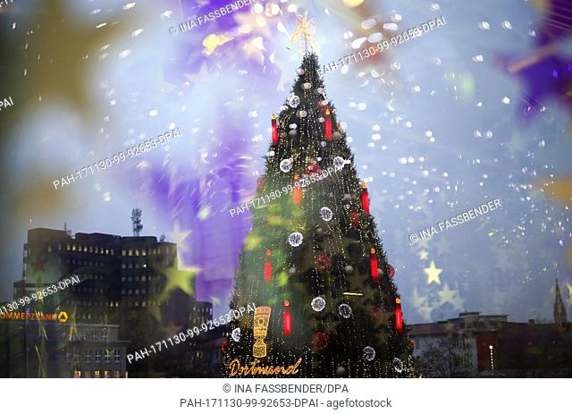 The according to the organisers biggest Christmas tree in the world illuminates the Christmas market in Dortmund, Germany, 30 November 2017