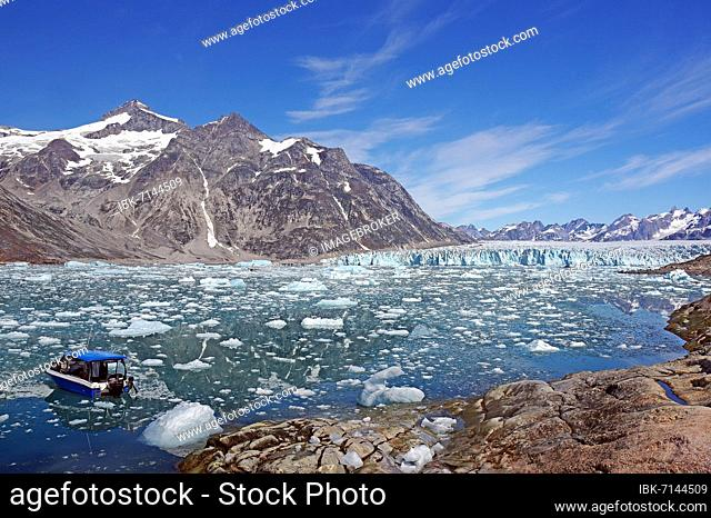 Boat in a fjord with drift ice, glacier and wild mountain landscape, Knud Rasmussen Glacier, Tasilaq, East Greenland, Greenland, Arctic, Denmark, North America
