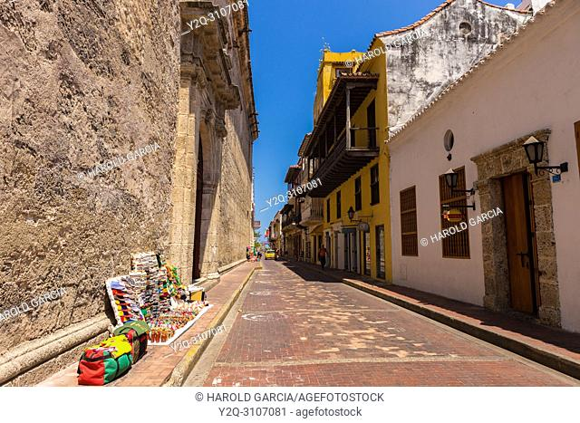 Streets of colonial houses with handicrafts of street vendors in the ancient walled city of Cartagena de Indias. UNESCO's historical heritage of humanity