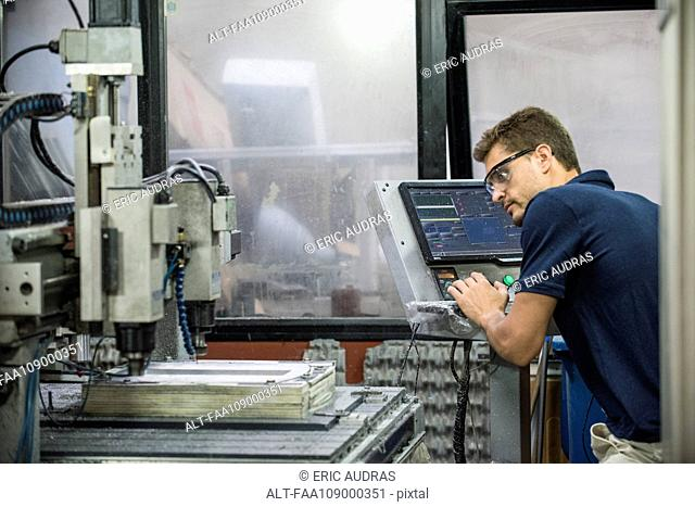 Machinist working in factory
