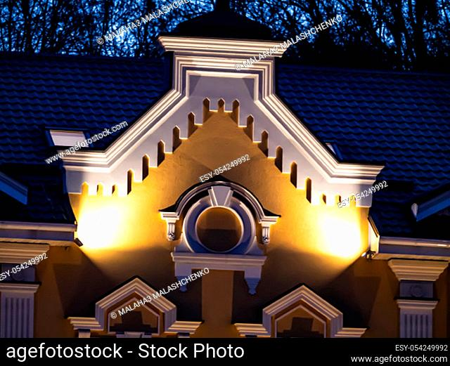 Night illumination of an old house. Background image. Place for text. Architecture